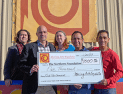 Moving Arts Española Presents $1,000 Check